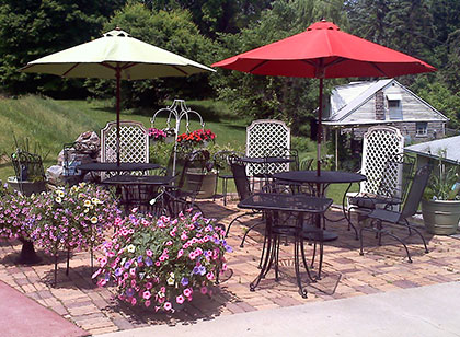 Patio with umbrellas, tables and chairs